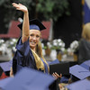 Jordan Neill waves at her family and friends after receiving her diploma during Legacy's graduation on Monday at Coors Event Center in Boulder.<br /> May 16, 2011<br /> staff photo/David R. Jennings