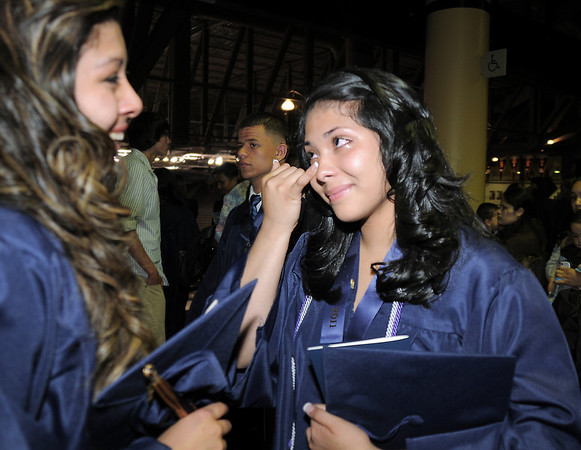 Ruby Marron, right, cries with Kirstie Norbori, left, after Legacy's graduation ceremony on Monday at Coors Event Center in Boulder.<br /> May 16, 2011<br /> staff photo/David R. Jennings