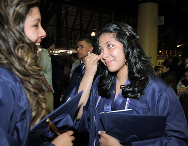 Ruby Marron, right, cries with Kirstie Norbori, left, after Legacy's graduation ceremony on Monday at Coors Event Center in Boulder. May 16, 2011 staff photo/David R. Jennings