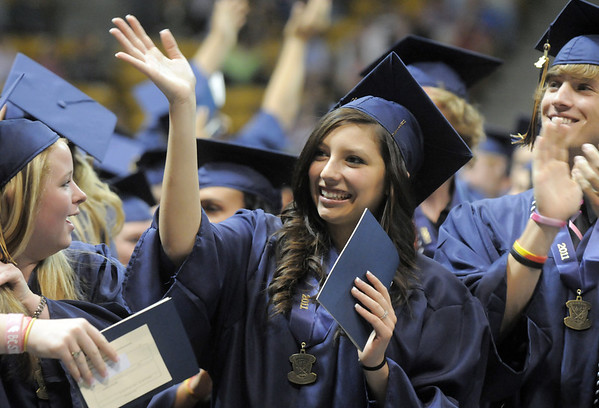 Mercedes Lewis waves at her family and friends during Legacy's graduation ceremony on Monday at Coors Event Center in Boulder.<br /> May 16, 2011<br /> staff photo/David R. Jennings