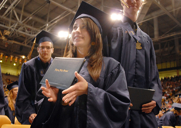 Brittany Leffel shows her family her diploma during Legacy's graduation ceremony on Monday at Coors Event Center in Boulder.<br /> May 16, 2011<br /> staff photo/David R. Jennings