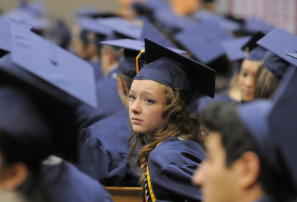Alexandra Van De Boogaard turns to listen to the Legacy Chorale singing during the graduation ceremony on Monday at Coors Event Center in Boulder.<br /> May 16, 2011<br /> staff photo/David R. Jennings