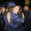 Kirstie Nobori, left, hugs Ruby Marron after Legacy's graduation on Monday at Coors Event Center in Boulder.<br /> May 16, 2011<br /> staff photo/David R. Jennings