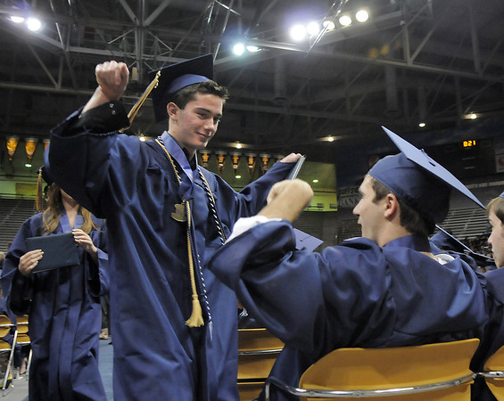 Cory King, left, greets Justin Walters after receiving their diplomas  during Legacy's graduation ceremony on Monday at Coors Event Center in Boulder.<br /> May 16, 2011<br /> staff photo/David R. Jennings