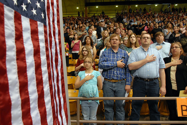 Audience members salute as the national anthem is sung by the Legacy Chorale during the graduation ceremony on Monday at Coors Event Center in Boulder.<br /> May 16, 2011<br /> staff photo/David R. Jennings