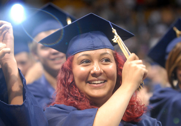 Brittany Lopez moves her tassel during the turning of the tassel at Legacy's graduation on Monday at Coors Event Center in Boulder.<br /> May 16, 2011<br /> staff photo/David R. Jennings