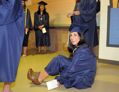 Carissa Loper sits on the floor while waiting for Legacy High School's graduation to begin on Monday at Coors Event Center in Boulder. May 16, 2011 staff photo/David R. Jennings