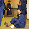 Carissa Loper sits on the floor while waiting for Legacy High School's graduation to begin on Monday at Coors Event Center in Boulder.<br /> May 16, 2011<br /> staff photo/David R. Jennings
