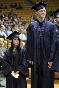 Brittany Leffel, left, stands next to classmate Mike Lehnerz during Legacy's graduation ceremony on Monday at Coors Event Center in Boulder. May 16, 2011 staff photo/David R. Jennings