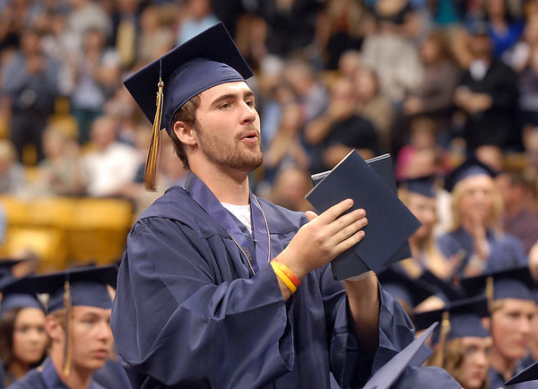Corey Ayers leads the standing ovation for retiring Legacy principal Cathy Nolan during the graduation ceremony on Monday at Coors Event Center in Boulder.<br /> May 16, 2011<br /> staff photo/David R. Jennings