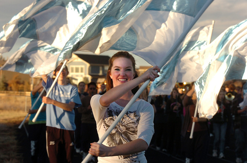 Legacy High Marching Band flag team member, Meghan Loftus prepares to perform while marching around the school's track during practice on Thursday.<br /> <br /> November 10, 2011<br /> staff photo/ David R. Jennings