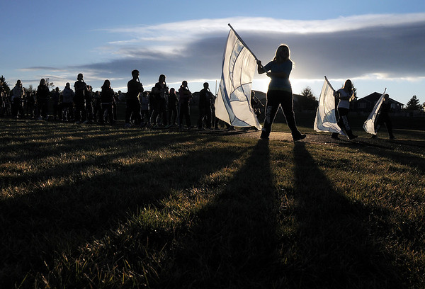 The flag team leads the Legacy High Marching Band around the school's track during practice on Thursday.<br /> <br /> November 10, 2011<br /> staff photo/ David R. Jennings