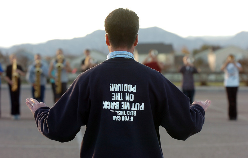 Legacy High Marching Band director Clay Standsberry directs the band in the school's parking lot during practice on Thursday.<br /> <br /> November 10, 2011<br /> staff photo/ David R. Jennings