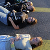Legacy High Marching Band flutists Hannah Wold, front, Stephanie Lane, bass clarinetist Katherine McConkey and flag team member Rue Hughes lay down on a speed bump in the school's parking lot during a break in practice on Thursday.<br /> <br /> November 10, 2011<br /> staff photo/ David R. Jennings