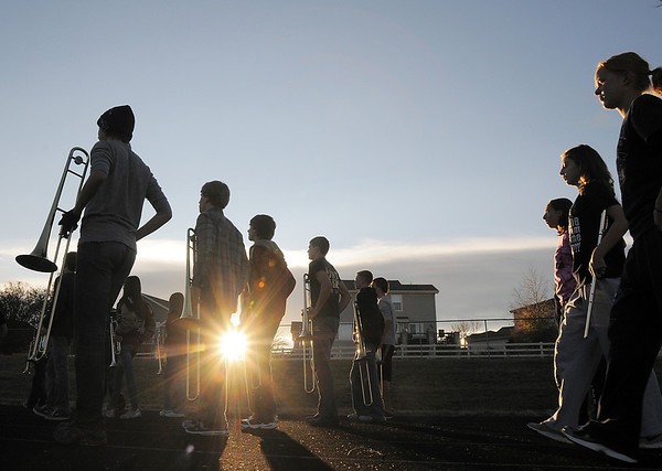Legacy High Marching Band marches around the school's track as the sun sets during practice on Thursday.<br /> <br /> <br /> November 10, 2011<br /> staff photo/ David R. Jennings