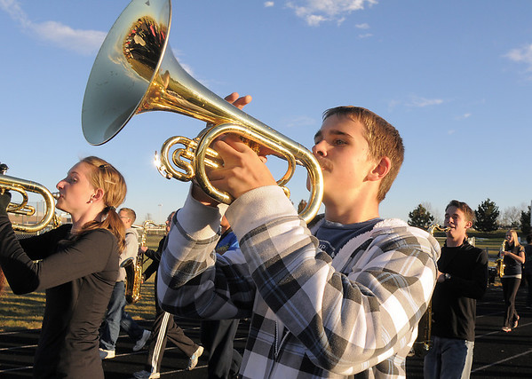 Legacy High Marching Band member John Hammond plays the mellophone while marching with the band around the school's track during practice on Thursday as they prepare for the 2.5 mile Macy's Parade in New York.<br /> <br /> <br /> November 10, 2011<br /> staff photo/ David R. Jennings