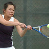 Legacy's Val Ho, returns the ball to Stephanie Giltner, Holy Family, during the #2 singles match at Legacy on Wednesday.<br /> <br /> <br /> March 31, 2010<br /> Staff photo/David R. Jennings