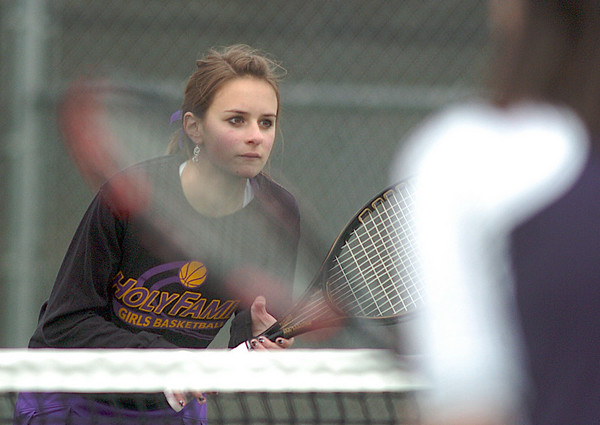 Madi Gosselin with doubles partner Mary Caldwell,  Holy Family, readies to play Legacy's Molly Madisen and Muriel Westover  during the #1 doubles match at Legacy on Wednesday.<br /> <br /> <br /> March 31, 2010<br /> Staff photo/David R. Jennings