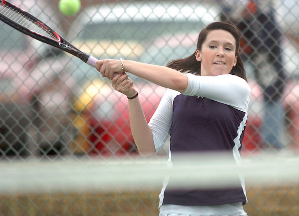 Legacy's Muriel Westover retunrs the ball with Molly Madisen during play against Holy Family's Mary Caldwell and Madi Gosselin in the #1 doubles match at Legacy on Wednesday.<br /> <br /> <br /> March 31, 2010<br /> Staff photo/David R. Jennings