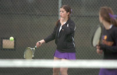 Mary Caldwell with doubles partner Madi Gosselin,  Holy Family, return the ball to Legacy's Molly Madisen and Muriel Westover  during the #1 doubles match at Legacy on Wednesday.   March 31, 2010 Staff photo/David R. Jennings