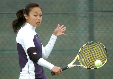 Kelly Vu, Legacy, returns the ball to Betta DeWitt, Holy Family, during the #1 singles match at Legacy on Wednesday.   March 31, 2010 Staff photo/David R. Jennings