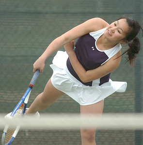 Legacy's Val Ho, serves the ball to Stephanie Giltner, Holy Family, during the #2 singles match at Legacy on Wednesday.   March 31, 2010 Staff photo/David R. Jennings