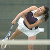 Legacy's Val Ho, serves the ball to Stephanie Giltner, Holy Family, during the #2 singles match at Legacy on Wednesday.<br /> <br /> <br /> March 31, 2010<br /> Staff photo/David R. Jennings