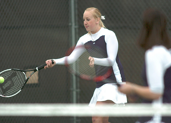 Legacy's Molly Madisen, left,  and Muriel Westover  play Holy Family's Mary Caldwell and Madi Gosselin in the #1 doubles match at Legacy on Wednesday.<br /> <br /> <br /> March 31, 2010<br /> Staff photo/David R. Jennings