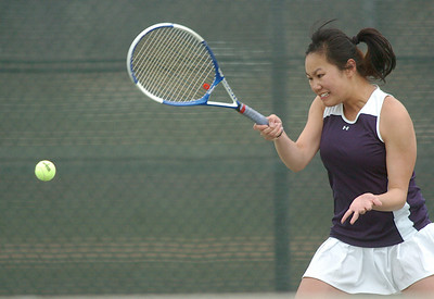 Legacy's Val Ho, returns the ball to Stephanie Giltner, Holy Family, during the #2 singles match at Legacy on Wednesday.   March 31, 2010 Staff photo/David R. Jennings