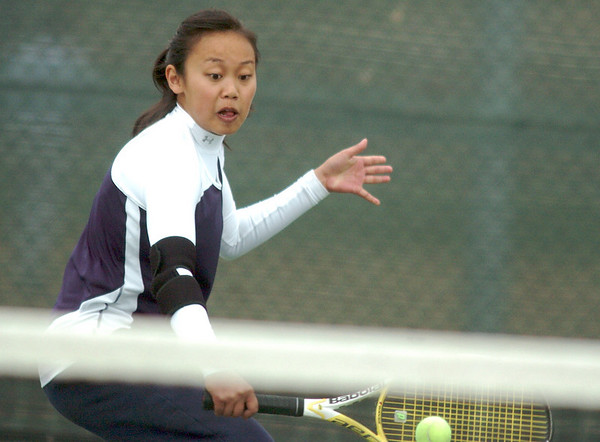 Kelly Vu, Legacy, returns the ball to Betta DeWitt, Holy Family, during the #1 singles match at Legacy on Wednesday.<br /> <br /> <br /> March 31, 2010<br /> Staff photo/David R. Jennings