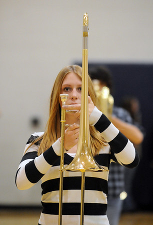 Kelsey Clark, trombone, Legacy High Marching Band, marches during practice at the school on Tuesday for the band's trip to London.<br /> December 8, 2009<br /> Staff photo/David R. Jennings