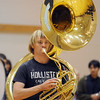 Erik Deines, Legacy High Marching Band, carries his tuba during practice at the school on Tuesday for the band's trip to London.<br /> December 8, 2009<br /> Staff photo/David R. Jennings