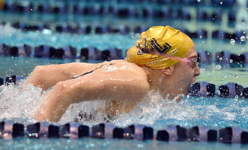 Legacy's Mary Lombardi swims the butterfly in the 200 yard IM during the dual meet between Monarch and Legacy at the Veterans Memorial Aquatic Center in Thornton on Thursday.<br /> December 20, 2012<br /> staff photo/ David R. Jennings