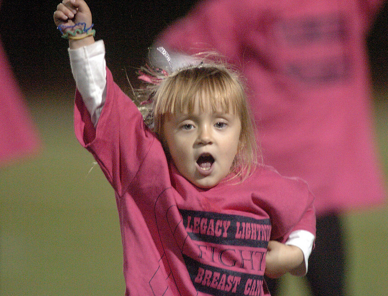Kaitlyn Sullivan, 4, cheers with the Legacy cheerleaders at half time during Thursday's Pink Out football game at North Stadium. The cheerleaders sold pink t-shirts, blankets and had a raffle for a pink Schwinn bicycle to raise money for breast cancer research.<br /> <br /> October 14, 2010<br /> staff photo/David R. Jennings
