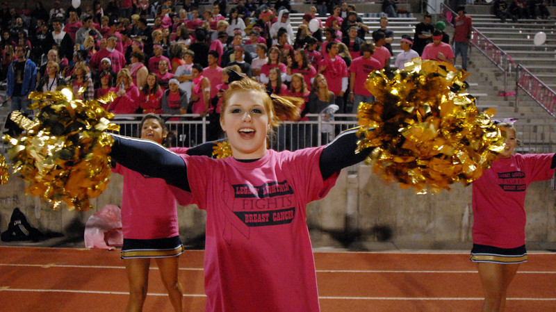 Legacy cheerleader Autumn Parks cheers with the team during Thursday's Pink Out football game at North Stadium. The cheerleaders sold pink t-shirts, blankets and had a raffle for a pink Schwinn bicycle to raise money for breast cancer research.<br /> <br /> October 14, 2010<br /> staff photo/David R. Jennings