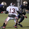 Legacy's Collin Randall runs around Pomona's Ricky Rodriguez during Thursday's game at North Stadium.<br /> October 27, 2011<br /> staff photo/ David R. Jennings