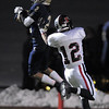 Legacy's Cameron McWee intercepts the ball intended for  Pomona's Brendan Ryan during Thursday's game at North Stadium.<br /> October 27, 2011<br /> staff photo/ David R. Jennings
