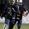 Legacy's Cameron McWee, right, runs downfield supported by Tate Wilson against Pomona during Thursday's game at North Stadium.<br /> October 27, 2011<br /> staff photo/ David R. Jennings