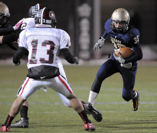 Legacy's Collin Randall advances the ball running past Pomona's Ricky Rodgriguez during Thursday's game at North Stadium.<br /> October 27, 2011<br /> staff photo/ David R. Jennings
