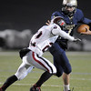 Legacy's quarterback Patrick Medina runs downfield agianst Pomona's Zach Perez during Thursday's game at North Stadium.<br /> October 27, 2011<br /> staff photo/ David R. Jennings