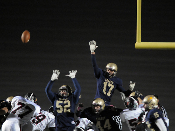 Legacy's Austin Yurko and Jake Chiddix attempt to block an extra point by Pomona during Thursday's game at North Stadium.<br /> October 27, 2011<br /> staff photo/ David R. Jennings