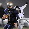 Legacy's quarterback Patrick Medina runs the ball downfield past Pomona's Zane Anderson during Thursday's game at North Stadium.<br /> October 27, 2011<br /> staff photo/ David R. Jennings