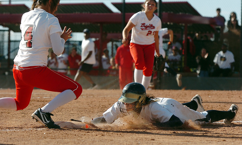 Legacy's Rainey Gaffin slides safely to third base past  Brighton's Natalie Sanchez  in the state 5A softball championship on Saturday at the Aurora Sports Park. <br /> October 22, 2011<br /> staff photo/ David R. Jennings
