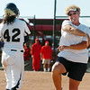 Legacy's coach Dawn Gaffin cheers after her daughter Rainey Gaffiin made it to third base against Brighton in the state 5A softball championship on Saturday at the Aurora Sports Park. <br /> October 22, 2011<br /> staff photo/ David R. Jennings