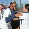 Legacy's Rainey Gaffin, left, celebrates with Jessica Ball after winning the state 5A championship defeating Brighton 4-1 on Saturday at the Aurora Sports Park. This marks the 5th state softball championship in a row for the Lightning.<br /> October 22, 2011<br /> staff photo/ David R. Jennings