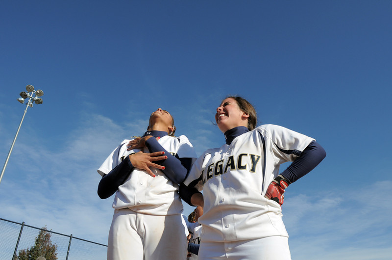 Legacy's Rainey Gaffin, left, and Jessica Ball show their happiness as they wait to celebrate after defeating Brighton 4-1 in the state 5A softball championship on Saturday at the Aurora Sports Park. This marks the 5th cahmpionship in a row for the LIghtning softball team.<br /> October 22, 2011<br /> staff photo/ David R. Jennings