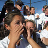 Legacy's Aspen Eubanks wipes her tears of joy as the Lightning prepares to pose for pictures with the state 5A softball championship trophy on Saturday at the Aurora Sports Park. This marks the 5th championship in a row for the LIghtning softball team.<br /> October 22, 2011<br /> staff photo/ David R. Jennings