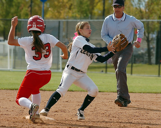 Legacy's Paige  Reichmuth tries to tag out Brighton's Ayla Robinson in the state 5A softball championship on Saturday at the Aurora Sports Park. <br /> October 22, 2011<br /> staff photo/ David R. Jennings