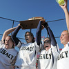 Legacy's Kelsey Dempsey, left, Rainey Gaffin, Jessica Ball and Kelsie Richardson hoist the state 5A championship trophy and game ball into the air after defeating Brighton 4-1 on Saturday at the Aurora Sports Park. This marks the 5th cahmpionship in a row for the LIghtning softball team.<br /> October 22, 2011<br /> staff photo/ David R. Jennings