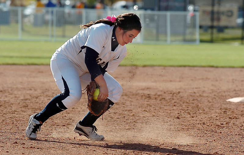 Legacy's Jessica Ball scoops up an infield ground ball from Brighton during the state 5A softball championship on Saturday at the Aurora Sports Park. <br /> October 22, 2011<br /> staff photo/ David R. Jennings